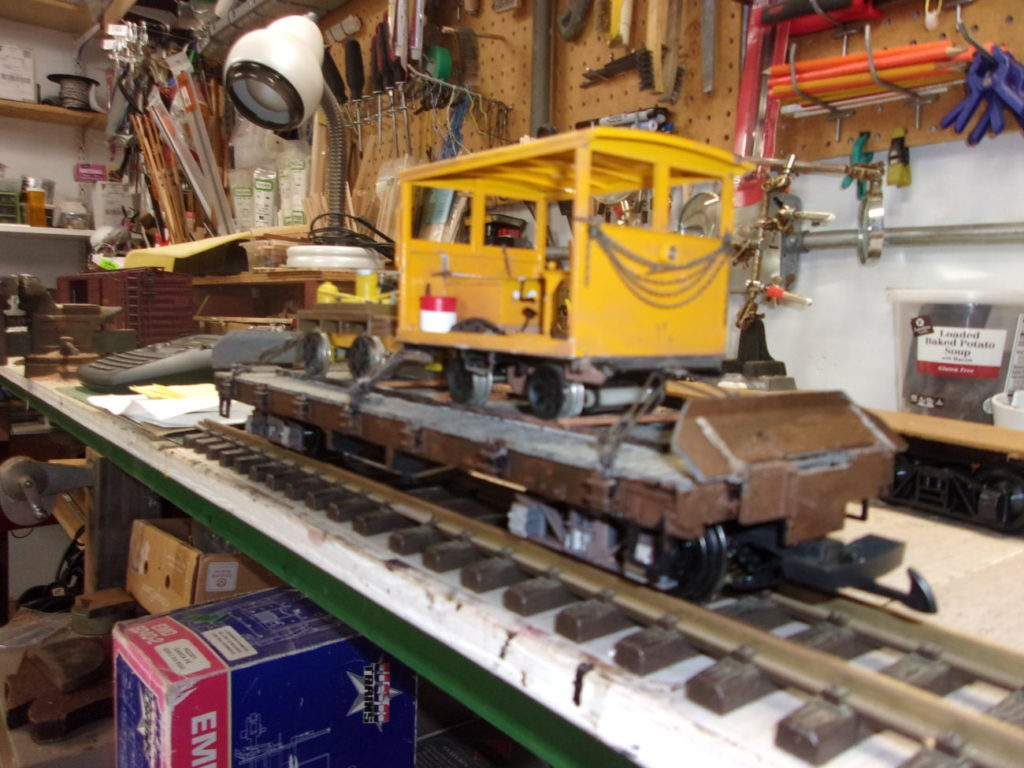 Chains have been added to keep the MOW on the flat car