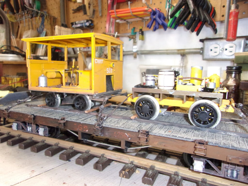 MOW placed on top of the flat car